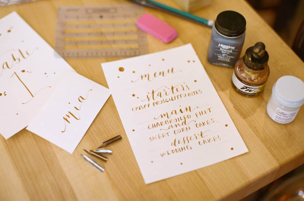 Calligraphy writing on paper with supplies