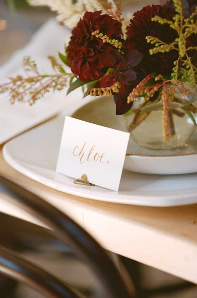 Place setting on plate at table with calligraphy writing.