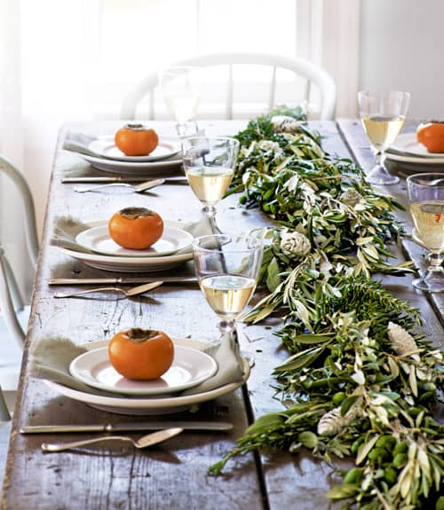 Easy tips and tricks for creating a beautiful, welcoming fall tablescape with natural elements like greenery, veggies, and simple fabrics.  #falltablescapeideas #tablescapes #tablescapeinspiration #falldecor