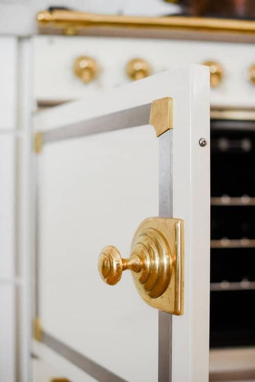 French oven range door with gold handle