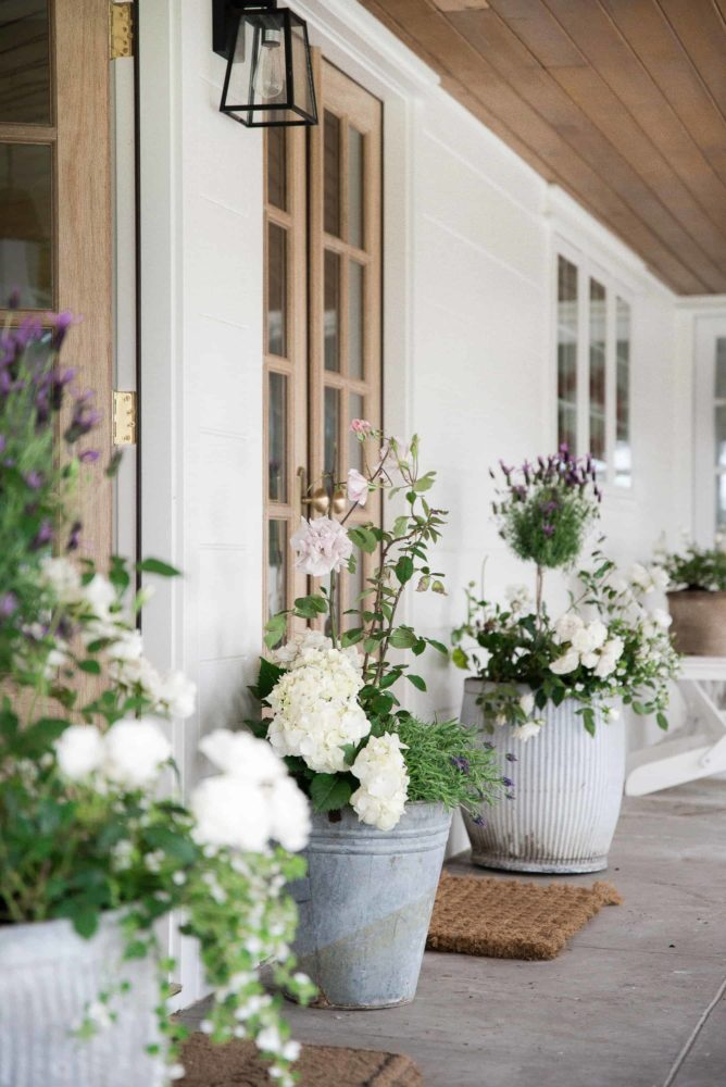 Wood French Doors exterior pictured with galvanized steel topiaries