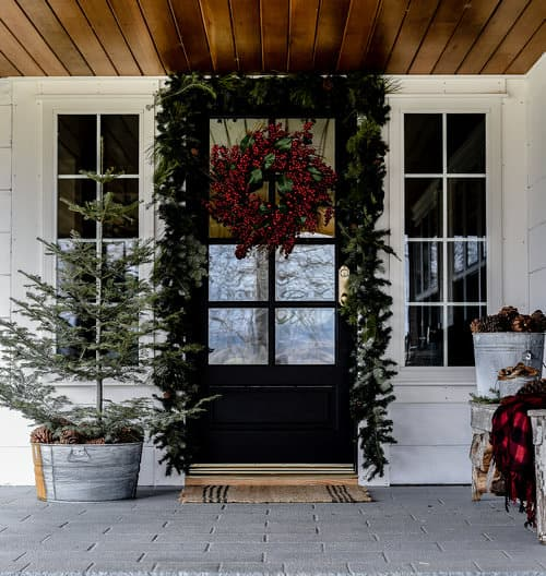 Create your own distressed galvanized buckets with toilet bowl cleaner and sand paper! The perfect home for Christmas trees, pine cones, and holiday decor!