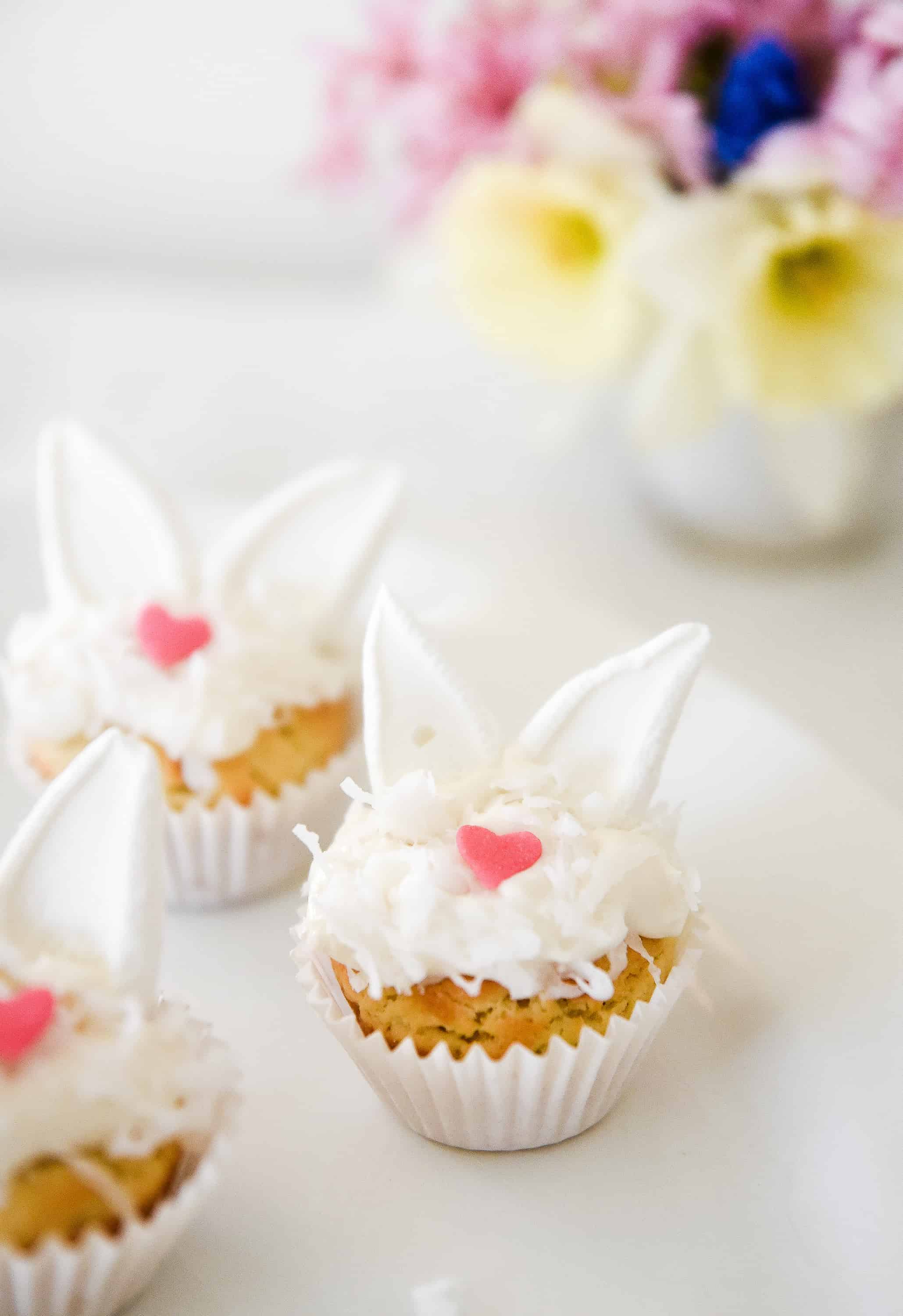 These Easter bunny sugar cookies couldn't get any sweeter! Take a simple sugar cookie and turn it into the perfect Easter dessert by adding marshmallow bunny ears!