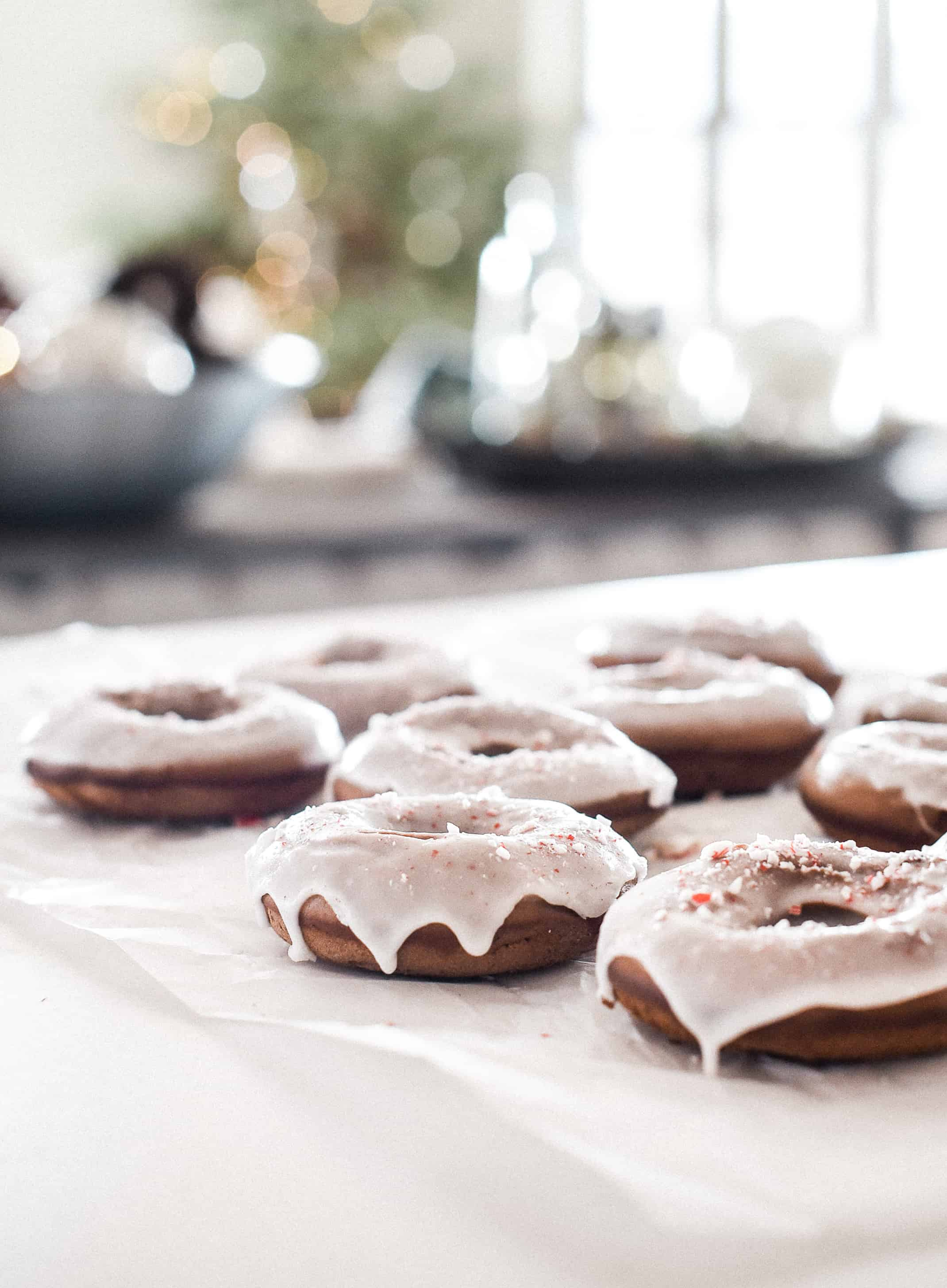 Baked peppermint bark Christmas donuts are the perfect treat to serve this holiday! These are fluffy, chocolatey, and have just the right amount of peppermint.