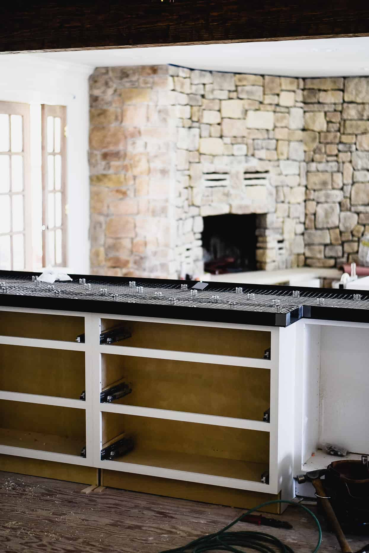 What I've learned about white concrete countertops in our kitchen! Should you DIY or hire a professional? Learn all about cement kitchen countertops…let's go!