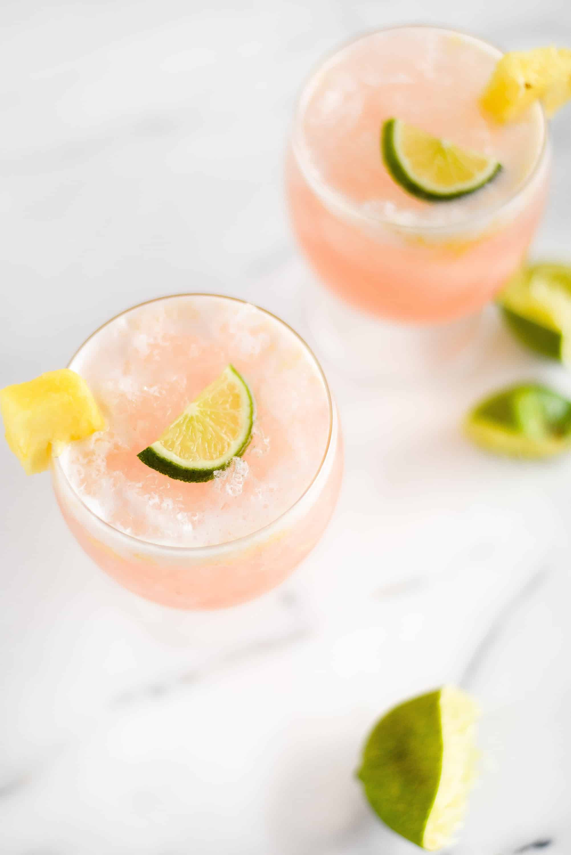 LaCroix is a wonderful way to lighten up cocktails without sacrificing flavor. You'll love this pineapple, coconut, guava, and lime cocktail, it tastes like paradise in a glass!