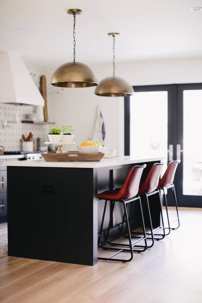 Kitchen Remodel with Dark Island and Brass Pendant with Leather Stools