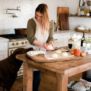 Girl making homemade pizza dough