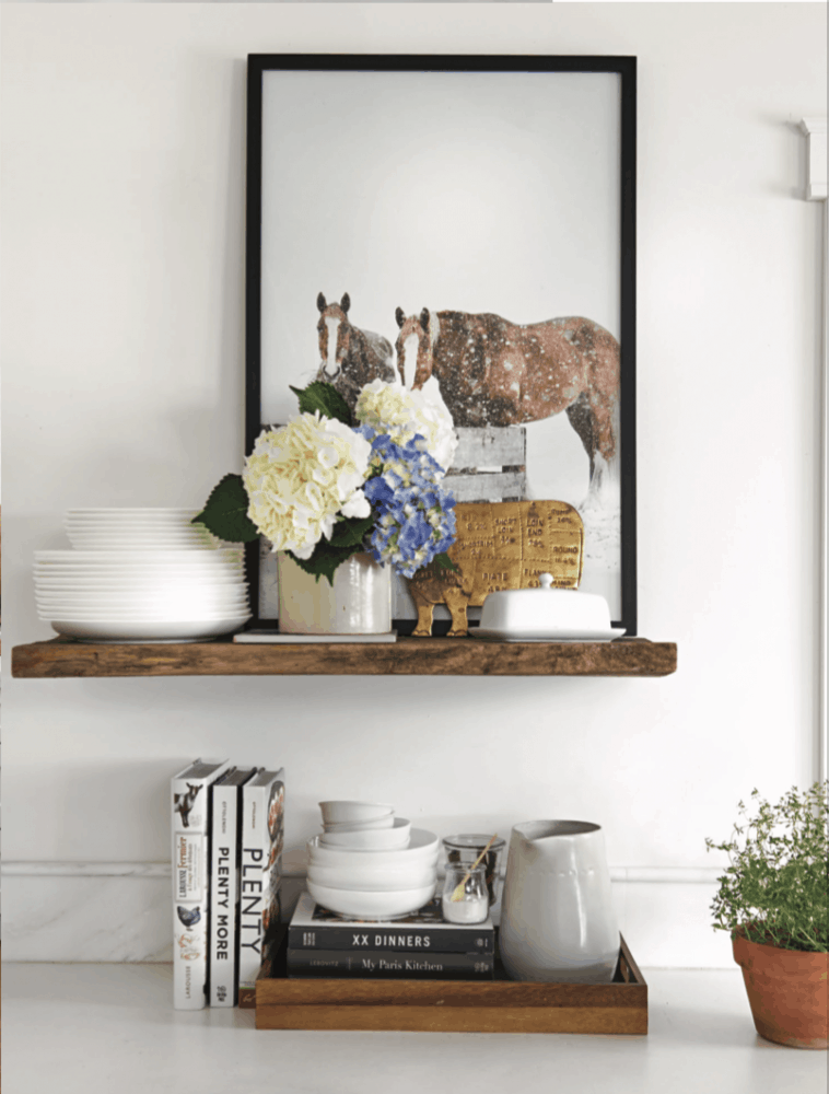 Picture of horse on floating shelf in farmhouse kitchen