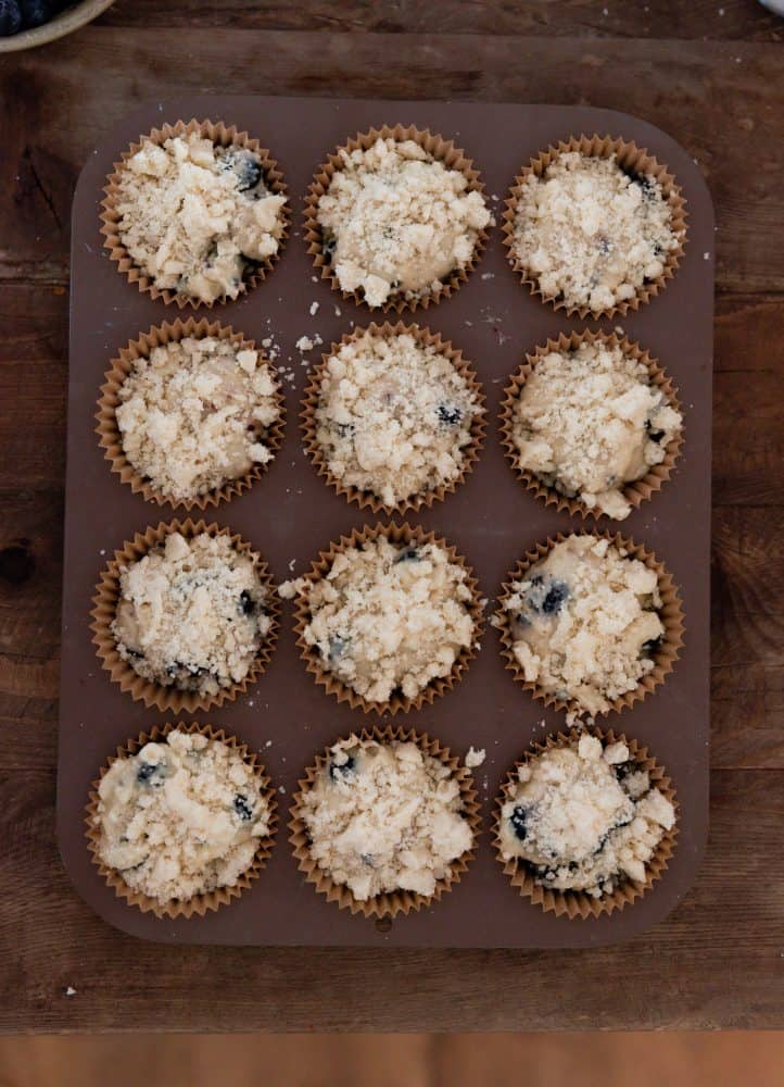 blueberry muffin batter in muffin tin