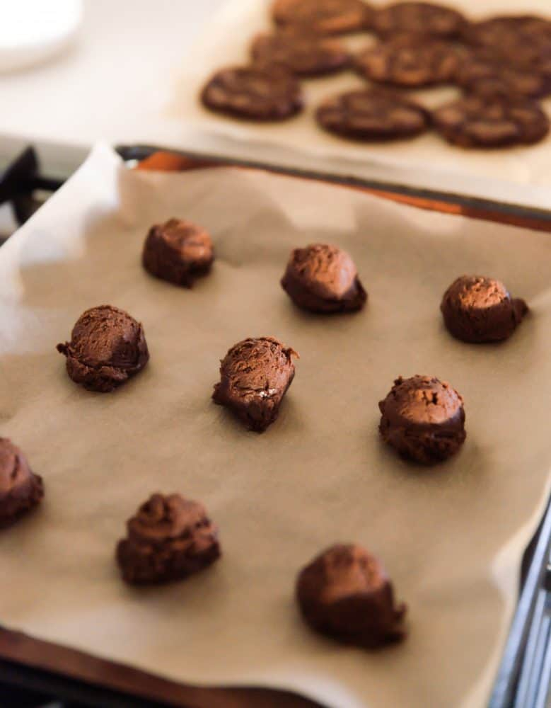 Scoops of Hot Cocoa Cookies on cookie sheet