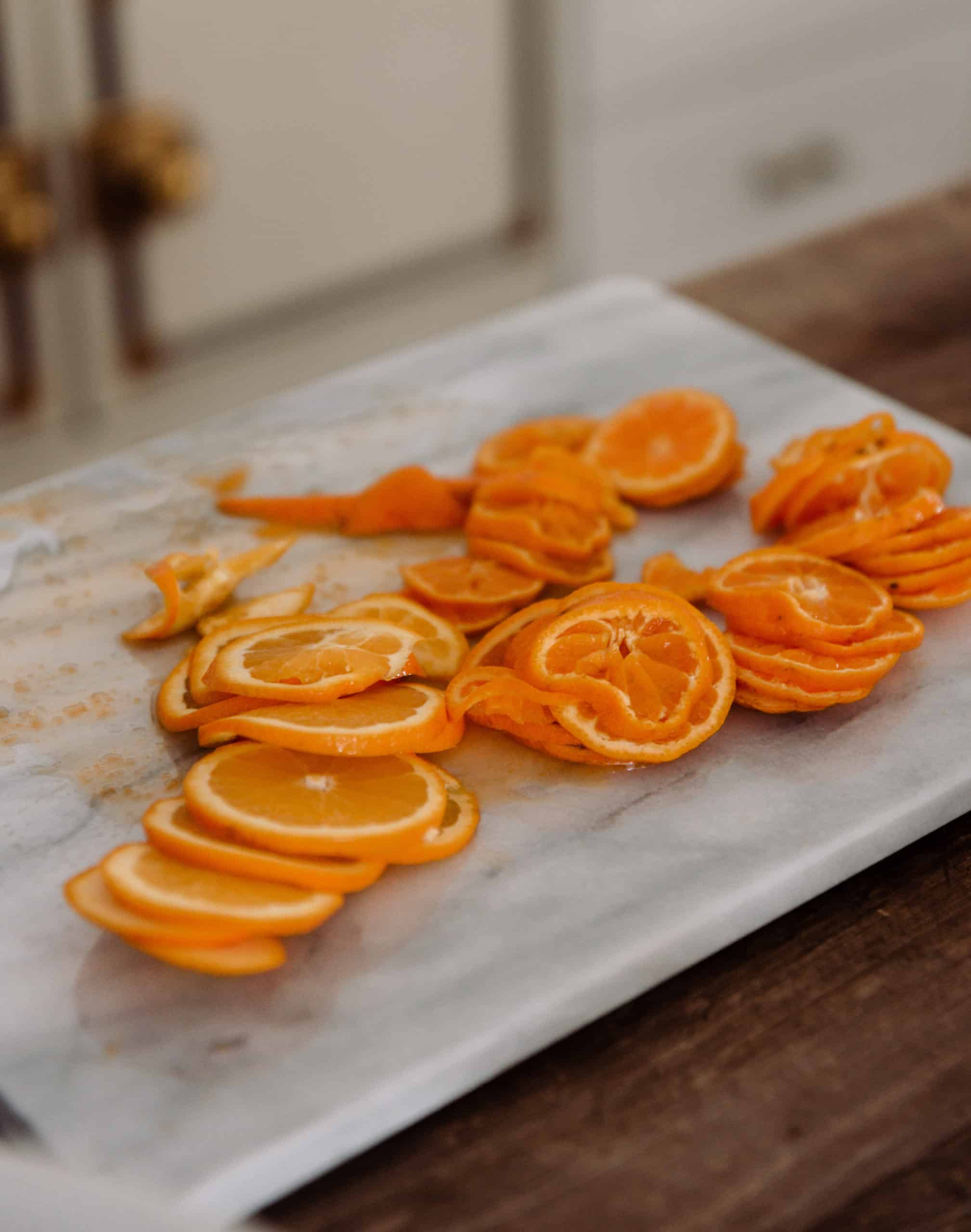 slide oranges on marble cutting board for orange marmalade
