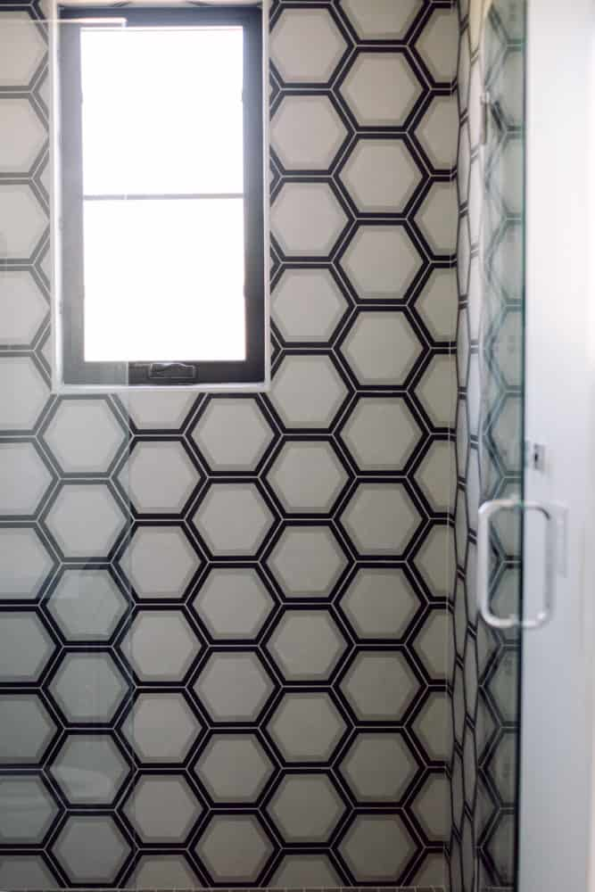 Shower with Grey and Black Pattern Wall Tile