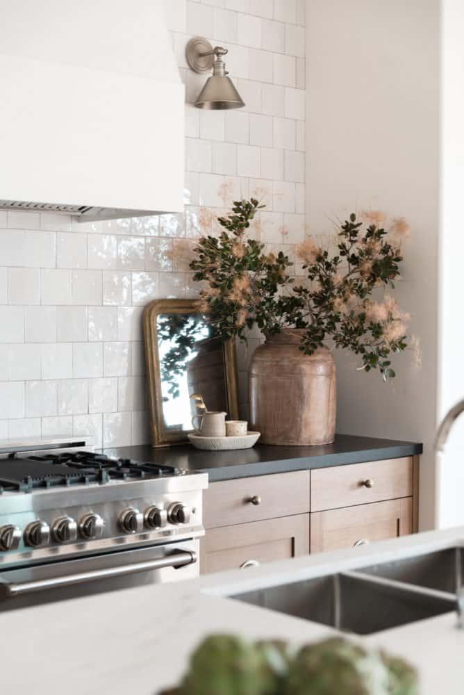 Dream kitchen interior design by Boxwood Avenue Interiors with white oak cabinets Cloe backsplash and marble countertops.