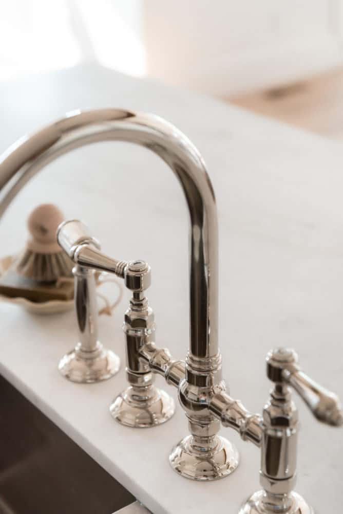 Beautiful Rohl kitchen sink faucet in polished nickel by Boxwood Avenue Interiors.
