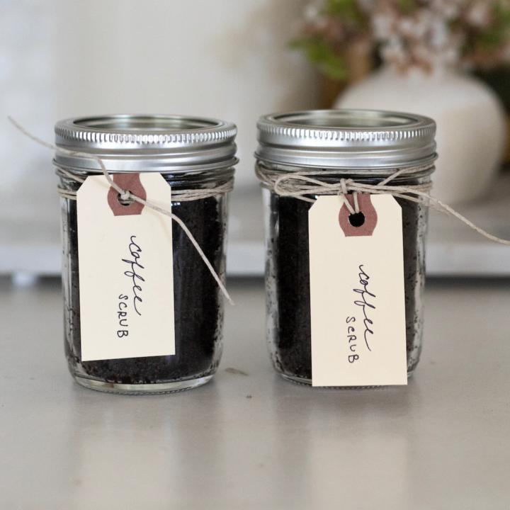 2 jars of rDIY coffee scrub on countertop