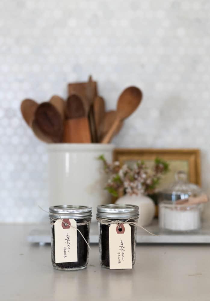 2 jars of DIY Coconut Coffee Scrub sitting on counter.